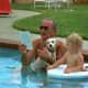 Lyndon B. Johnson holding Yuki, his mixed breed dog.
