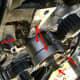 Installing the new timing belt idler pulley, tensioner spring, balance shaft pulley, pulley bracket, and bracket bolt.