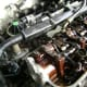Remove electrical fittings and coolant plumbing.