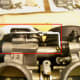 Remove the choke lever (circled in red).