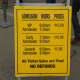 A Sign Listing Hours and Prices