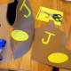 """Cut out 2 yellows ovals and the letter """"J"""" out of craft foam sheets."""