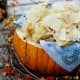 Dips or chips can be served in a pumpkin when hosting a party.