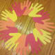 Use a glue stick or tape to connect hands together to make a wreath.