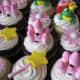 Pink birthday cupcakes.