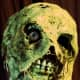 Zombie, buried six feet deep, come and eat my brains, you creep!