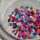 Perler beads in the oven-safe bowl.