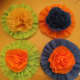 Rosettes embellished with crepe paper carnations.