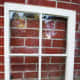 Start with an old window.  Clean and prep it so that you can paint the frame.