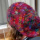 The back of the hat is floppy and shows off the sari yarn colours well.