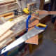 Shortening the two ends of the middle shelf, to account for the dado joint in the two end supports.