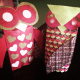 Two very different owls—a very simple design done on a red bag (left) vs. a highly decorated owl on a brown bag that you can't even see anymore.