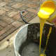 Pour paint directly into the concrete to achieve your desired color