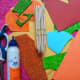 Acrylic paint, a brush, six ice cream sticks, a glue stick, scissors, a few sheets of colored, textured, and shiny paper.