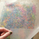 crayons are sandwiched between two sheets of waxpaper