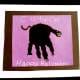 A black handprint makes a cute halloween cat.
