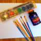 The supplies to create rubber cement art.