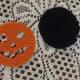 Orange face ready to hot glue onto the black backing.