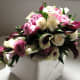Cascade of calla lily and roses in subtle purple and rose is lush and romantic..