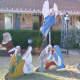 Santa Bows to Jesus in back of display