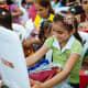 A girl opening her shoebox in Ecuador.