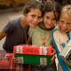 Girl holding their shoeboxes at an OCC distribution event in Uruguay.