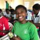 A girl opening her shoebox in Rwanda.