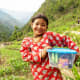 A girl holding her shoebox in Nepal.