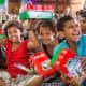 Girls showing off their shoebox gifts in Fiji.