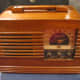 A 1940s radio where the family heard news and listened to the President give updates on the progress of the war.