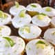 Top the frosting with fresh slices of lime and grated lime zest.