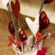 Tuck a piece of festive ribbon into your vase to add whimsy and interest.