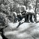 """""""Billy, Tommy, Peggy & Johnny on rock in park below Devils Tower"""""""