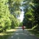 A jogger runs along the trail