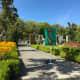 Walking through the Italian Garden to the animated dinosaur exhibit