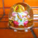 A Ganeesh snowglobe. Instead of snow, golden coins and golden glitter swirl around.....a good souvenir that is supposed to attract money.