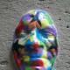 A mask decorating a side street (c) A. Harrison
