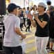 """Many of the performing """"stations"""" had locals spiritedly dancing to recorded Cantopop."""