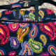 The Vera Bradley Grand Traveler Bag holds a ton and folds flat for easy storage in your cabin.