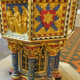 A close up of the decorated christening font
