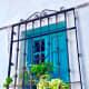 Beautiful turquoise window facing the street.