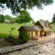 Miniature buildings along train tracks
