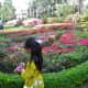 Girl walking by the butterfly shaped garden