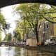 Amsterdam framed by a bridge.