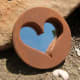 This mirror is unique in that it not only incorporates stone, but a heart. Both work to create peace, love and positive feng shui energies.