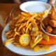 A pound of fried scallops and crispy french fries. We ate on the outside deck where we had a great view of sailboats moored at the dock.
