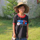 Alisa's brother 'Lucky' standing in the grounds of the temple, wearing my oversized hat while I took my photos