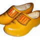 An example of wooden shoes that would be made in the factory.