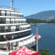 A cruise ship with part of Stanley Park in the background