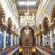 Well-lit interior of Jerusalem Synagogue.